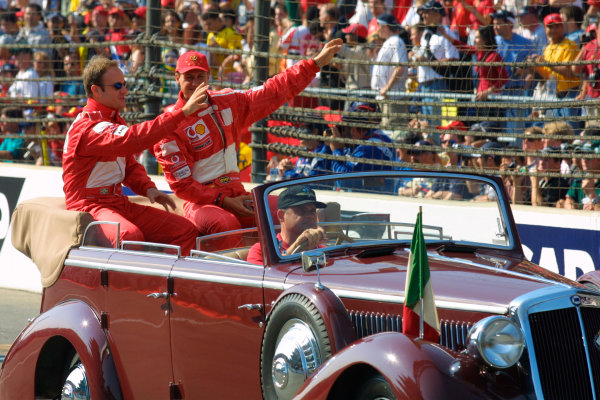 2002 American Grand Prix.Indianapolis, Indiana, USA. 27-29 September 2002.Michael Schumacher and Rubens Barrichello (both Ferrari) have a bit of fun on the drivers parade. World Copyright - LAT Photographicref: Digital File Only