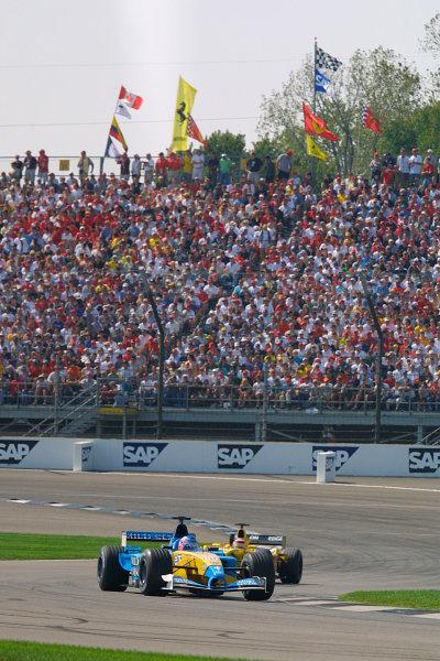 2002 American Grand Prix.Indianapolis, Indiana, USA. 27-29 September 2002.Jenson Button (Renault R202) with Takuma Sato (Jordan EJ12 Honda) behind.World Copyright - LAT Photographicref: Digital File Only