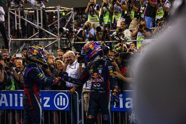 Sebastian Vettel and Mark Webber celebrate a 1-2 finish.