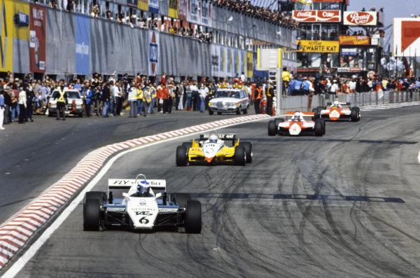 Keke Rosberg, Williams FW08 Ford, leads Alain Prost, Renault RE30B, Niki Lauda, McLaren MP4-1B Ford, and Andrea de Cesaris, Alfa Romeo 182.