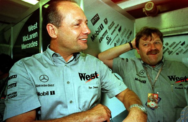 1997 Hungarian Grand Prix.Hungaroring, Budapest, Hungary.8-10 August 1997.Ron Dennis and Norbert Haug (right, Daimler-Benz Motorsport) after practice. World Copyright - LAT Photographic