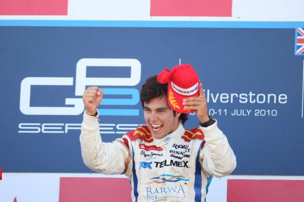 Silverstone, England. 11th July.Sunday Race. Sergio Perez (MEX, Barwa Addax Team) celebrates his victory on the podium. Photo: Jakob Ebrey/GP2 Media Service.Ref: _MKO_9379 jpg