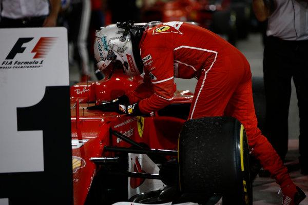 Bahrain International Circuit, Sakhir, Bahrain.  Sunday 16 April 2017. Sebastian Vettel, Ferrari, 1st Position, celebrates in Parc Ferme. World Copyright: Andrew Hone/LAT Images ref: Digital Image _ONY8517