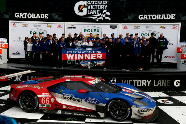 2017 Rolex 24 Hours. Daytona, Florida, USA Sunday 29 January 2017. Race winner GTLM: #66 Ford Performance Chip Ganassi Racing Ford GT: Joey Hand, Dirk M?ller, S?bastien Bourdais with the team World Copyright: Alexander Trienitz/LAT Images ref: Digital Image 2017-24h-Daytona-AT1-6119