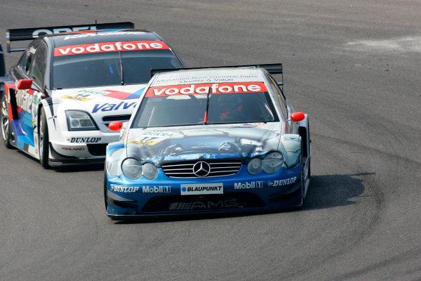 2004 DTM ChampionshipZandvoort, Netherlands. 4th - 5th September.Markus Winkelhock (Persson Motorsport Mercedes CLK) leads Peter Dumbreck (OPC Phoenix Opel Vectra GTS). Action.World Copyright: Andre Irlmeier/LAT Photographicref: Digital Image Only