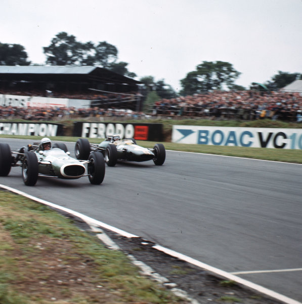Brands Hatch, England.14-16 July 1966.Chris Lawrence (Cooper T73 Ferrari) is passed by Jim Clark (Lotus 33 Climax). Clark finished in 4th position.Ref-3/2264.World Copyright - LAT Photographic