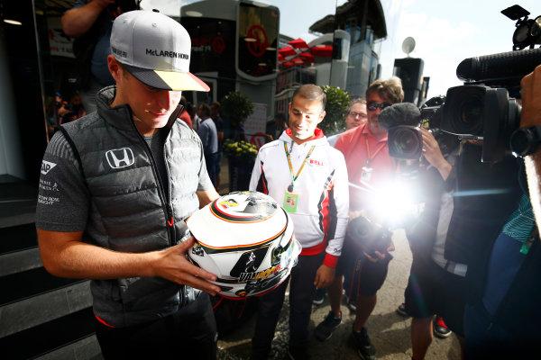 Spa Francorchamps, Belgium.  Thursday 24 August 2017. Stoffel Vandoorne, McLaren, examines a helmet in front of media. World Copyright: Andy Hone/LAT Images  ref: Digital Image _ONZ8215