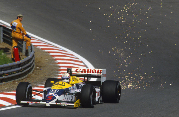 Spa-Francorchamps, Belgium. 23-25 May 1986. Nigel Mansell, Williams FW11 Honda, 1st position, at Eau Rouge. Ref: 86BEL02. World Copyright - LAT Photographic