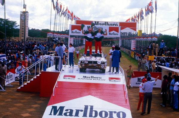 Safari Rally, Kenya. 4th - 8th April 1985.Juha Kankkunen/Fred Gallagher (Toyota Celica TCT), 1st position, podium, portrait.World Copyright: LAT PhotographicRef: Colour Transparency.