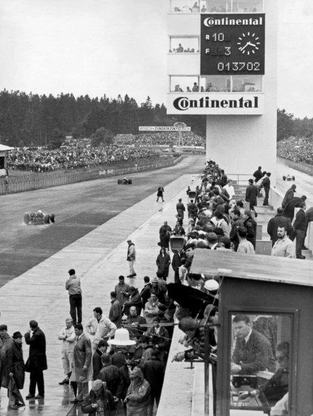 1966 German Grand Prix.Nurburgring, Germany. 7 August 1966.The pit lane, atmosphere.World Copyright: LAT PhotographicRef: Autosport b&w print