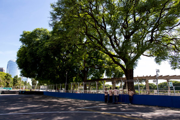 2015/2016 FIA Formula E Championship. Buenos Aires ePrix, Buenos Aires, Argentina. Friday 5 February 2016. Track workers rest in the shade. Photo: Zak Mauger/LAT/Formula E ref: Digital Image _L0U9859