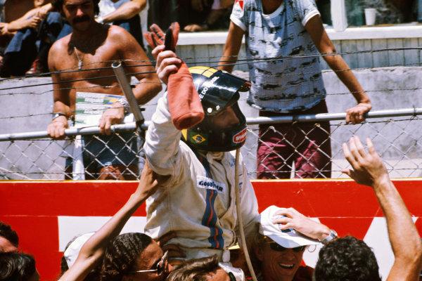 1975 Brazilian Grand Prix  Interlagos, Sao Paulo, Brazil. 24-26th January 1975.  Carlos Pace, Brabham, celebrates victory.  Ref: 75BRA13. World copyright: LAT Photographic