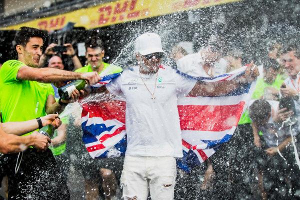 Autodromo Hermanos Rodriguez, Mexico City, Mexico. Sunday 29 October 2017. The mercedes team shower Lewis Hamilton, Mercedes AMG, newly crowned 4 times world champion, with Champagne. World Copyright: Zak Mauger/LAT Images  ref: Digital Image _31I8171