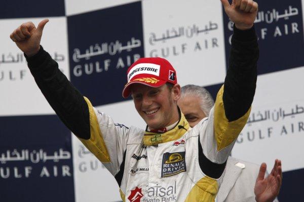 2008 GP2 Asia Series. Saturday Race.Bahrain International Circuit. Sakhir, Bahrain. 5th April. Romain Grosjean (FRA, ART Grand Prix) celebrates victory on the podium. World Copyright: Andrew Ferraro/GP2 Series Media Service. Service ref:__H0Y2638 jpg