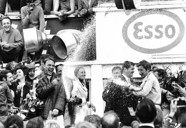 Le Mans, France.10-11 June 1967.Dan Gurney and AJ Foyt (Ford) celebrate finishing in 1st position with Jo Siffert (Porsche, right with champagne) and Jean Marie Dubois of Moet. This was the first time champagne was sprayed in celebration.Published-Autocar 15/6/1967 p15.World Copyright - LAT Photographic