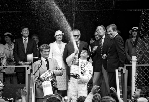 Race winner Jody Scheckter (RSA) celebrates with the champagne on the podium. Monaco Grand Prix, Rd 7, Monte Carlo, Monaco, 27 May 1979.