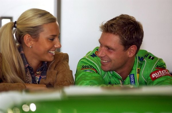 Bernd Maylander (GER), Oase AMG-Mercedes, has a laugh with his girlfriend while waiting for the start of the delayed qualifying session.DTM Championship, Rd9, Zandvoort, Holland. 29 September 2002.DIGITAL IMAGE