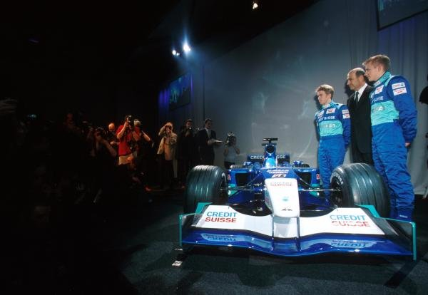 The new Sauber C20 is paraded for the first time along with team owner Peter SauberÕs (centre) choice of drivers for the upcoming season Ð Nick Heidfeld (GER) (left) and Kimi Raikkonen (FIN) (Right).Sauber Car Launch, Hinwell, Switzerland, 24 January 2001.
