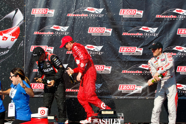 14 July, 2013,  Toronto, Ontario, CAN Sebastien Bourdais shows Scott Dixon and Helio Castroneves how to celebrate with champagne ©2013, Phillip Abbott LAT Photo USA