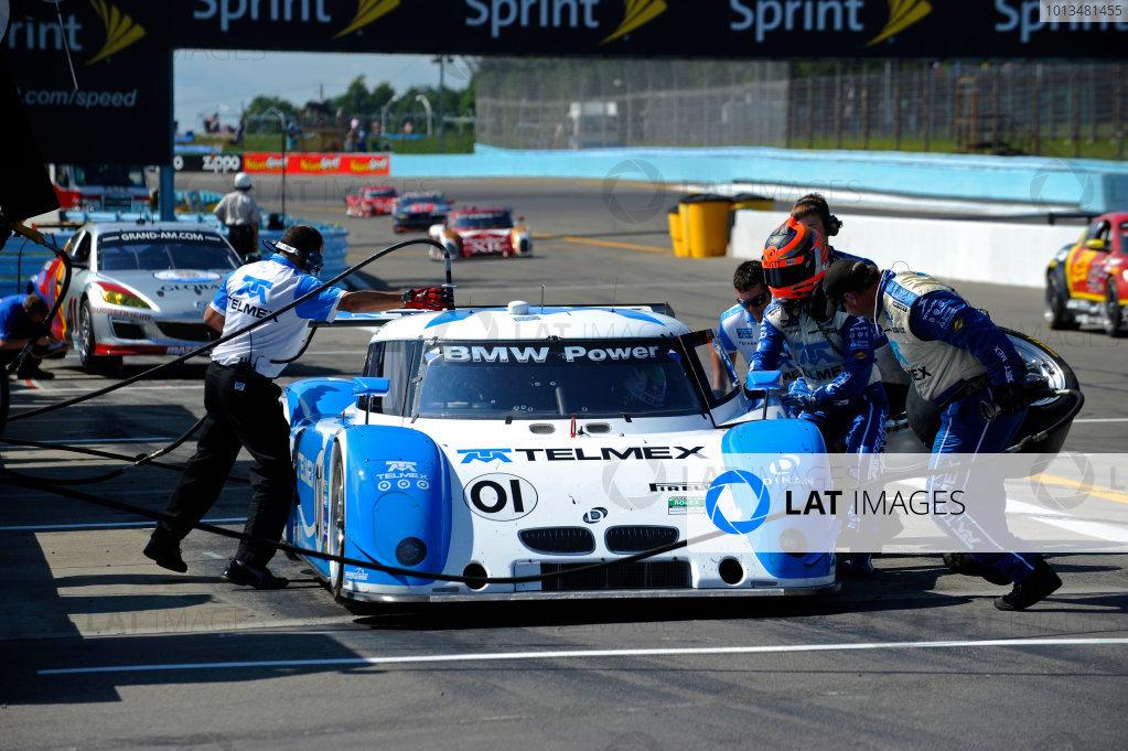 6-7 August, 2010, Watkins Glen, New York USA#01 Chip Ganassi Racing with Felix Sabates BMW/Riley preforms a practice pitstop.©2010 F Peirce Williams, USALAT Photographic
