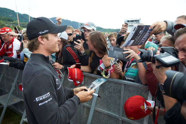 Red Bull Ring, Spielberg, Austria. Saturday 20 June 2015. Nico Rosberg, Mercedes AMG, signs autographs for fans. World Copyright: Steve Etherington/LAT Photographic. ref: Digital Image SNE24285