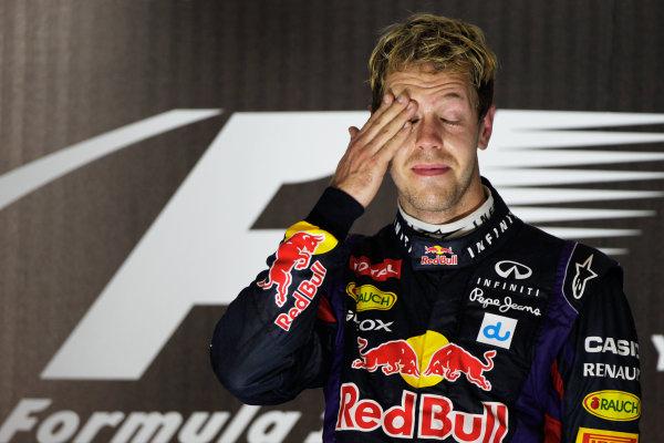 Yas Marina Circuit, Abu Dhabi, United Arab Emirates. Sunday 3rd November 2013. Sebastian Vettel, Red Bull Racing, 1st position, celebrates on the podium. World Copyright: Andy Hone/LAT Photographic. ref: Digital Image _ONY1468