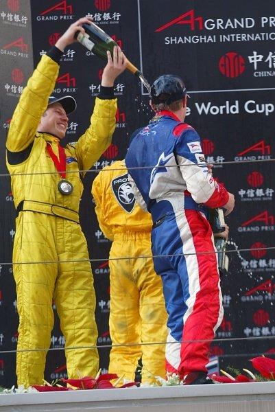 Tomas Enge (CZE) A1 Team Czech Republic and Ryan Briscoe (AUS) A1 Team Australia on the feature race podium.A1 Grand Prix, Rd11, Race Day, Shanghai, China, 2 April 2006.DIGITAL IMAGE