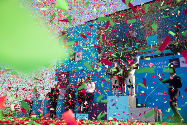 Confetti rains down as Robin Frijns (NLD), Envision Virgin Racing, 2nd position, Jérôme d'Ambrosio (BEL), Mahindra Racing, 1st position, and Sam Bird (GBR), Envision Virgin Racing, 3rd position, celebrate on the podium