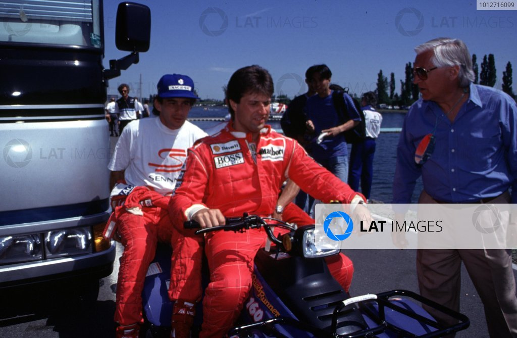 1993 Canadian Grand Prix.Montreal, Quebec, Canada.11-13 June 1993.Michael Andretti gives McLaren Ford team mate Ayrton Senna a lift on his quad bike.World Copyright - LAT Photographic