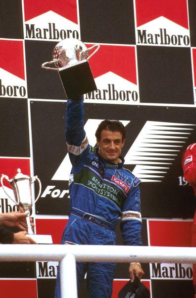 Catalunya, Barcelona, Spain.31 May - 2 June 1996.Jean Alesi (Benetton B196 Renault) 2nd position, celebrates on the podium.Ref-96 ESP 02.World Copyright - LAT Photographic
