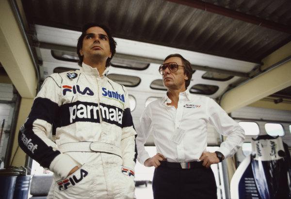 Nelson Piquet with Brabham team owner Bernie Ecclestone during practice.