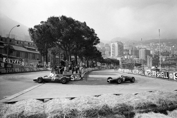 John Surtees, Ferrari 312, leads Jackie Stewart, BRM P261, at Gasworks hairpin.