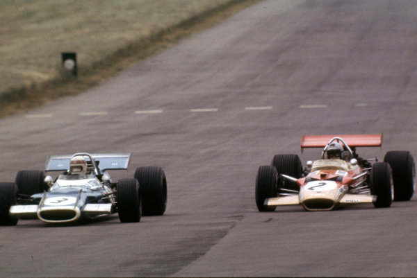 1969 British Grand Prix. Silverstone, England. 17-19 July 1969. Jackie Stewart (Matra MS80 Ford) leads Jochen Rindt (Lotus 49B Ford). They finished in 1st and 4th positions respectively. World Copyright - LAT Photographic. Ref: 69GB04.