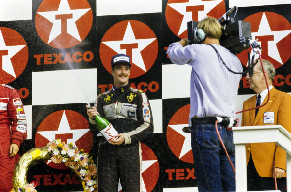 Nigel Mansell, 3rd position, celebrates on the podium.