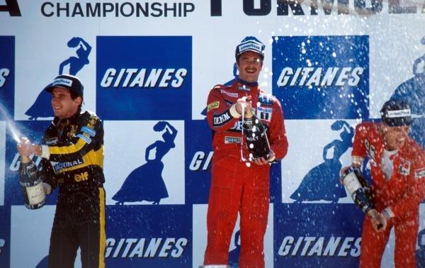 The podium (L to R): Ayrton Senna (BRA) Lotus second; Nigel Mansell (GBR) Williams winner; Stefan Johansson (SWE) Ferrari third. Belgian Grand Prix, Spa-Francorchamps, 25 May 1986.