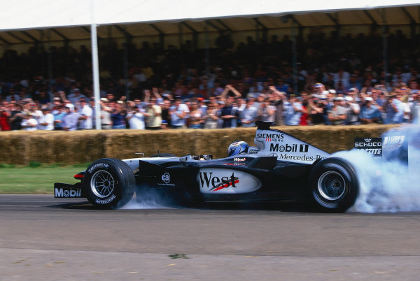 2002 Goodwood Festival of SpeedGoodwood, England. 12th - 14th July 2002.Darren Turner smokes the rear tyres of the West McLaren Mercedes MP4/17.World Copyright: Jeff Bloxham/LAT Photographicref: 35mm Image A06
