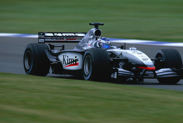2002 British Grand Prix, Silverstone, England. 7th July 2002. Kimi Raikkonen was electrifying in the McLaren until his engine let go.World Copyright - LAT Photographic Ref: 35mm Original A25