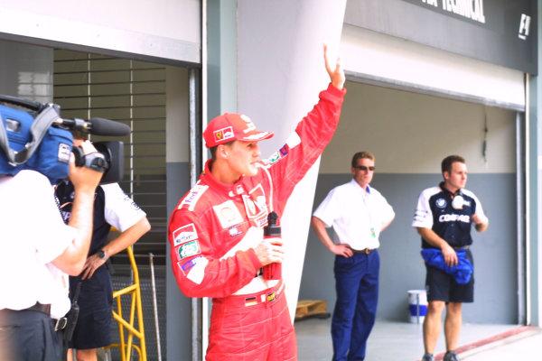 2001 Malaysian Grand Prix.Sepang, Kuala Lumpur, Malaysia. 16-18 March 2001.Michael Schumacher (Ferrari) celebrates his pole position in parc ferme.World Copyright - LAT Photographicref: 8 9MB DIGITAL IMAGE