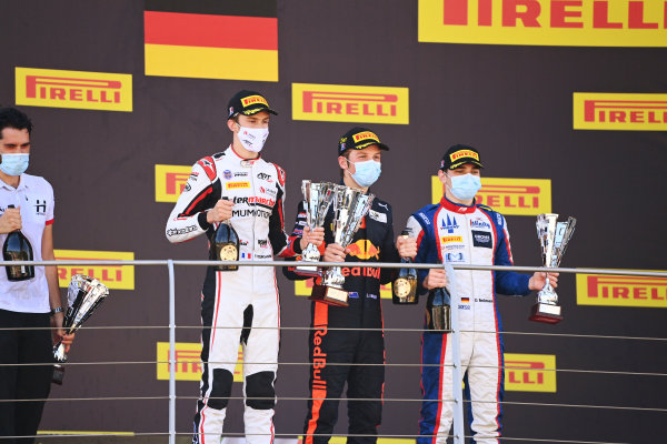 Winner Liam Lawson (NZL, HITECH GRAND PRIX), celebrates on the podium with David Beckmann (DEU, TRIDENT) and Theo Pourchaire (FRA, ART GRAND PRIX)