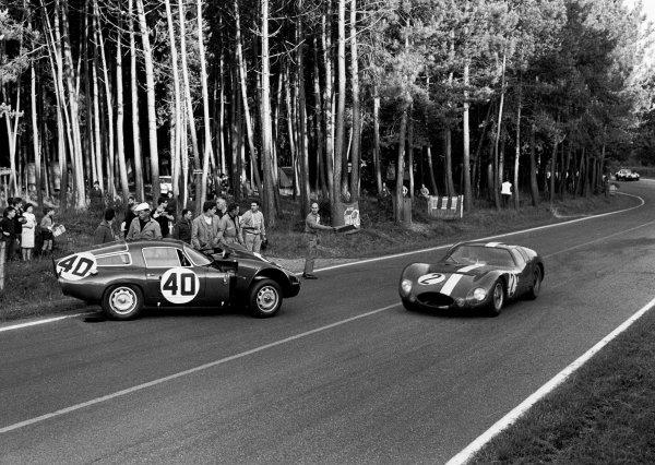 Le Mans, France. 20th - 21st June 1964 Andre Simon/Maurice Trintignant (Maserati 151/3), retired, passes the crashed Fernand Masoero/Jean Rolland (Alfa Romeo Giulia TZ), retired, action. World Copyright: LAT Photographic Ref: