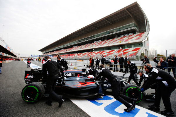Circuit de Catalunya, Barcelona, Spain Monday 22 February 2016. Jenson Button, McLaren MP4-31 Honda, gets pushed back into the garage. World Copyright: Steven Tee/LAT Photographic ref: Digital Image _L4R7119