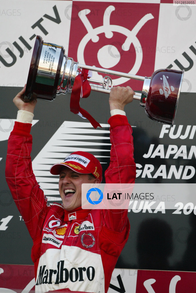 2004 Japanese Grand Prix - Sunday Race, 2004 Japanese Grand Prix Suzuka, Japan. 10th October 2004.Michael Schumacher, Ferrari F2004 celebrates on the podium.World Copyright: Steve Etherington/LAT Photographicref: Digital Image Only