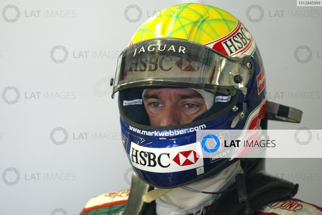 2004 Hungarian Grand Prix - Friday Practice,2004 Hungarian Grand Prix Budapest, Hungary. 13th August 2004 Mark Webber, Jaguar R5 puts on his helmet ready for the start of friday practice session.World Copyright: Steve Etherington/LAT Photographic ref: Digital Image Only