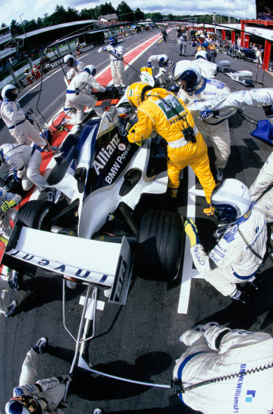 2004 Belgian Grand Prix.Spa Francorchamps, Belgium. 27th - 29th August.Juan Pablo Montoya, WilliamsF1 BMW FW26 takes a pit - stop during the race. Action. World Copyright:LAT PhotographicRef:35mm Image A11