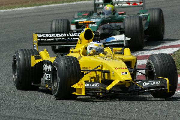 2003 Spanish Grand Prix - Sunday Race,Barcelona, Spain.4th May 2003.Giancarlo Fisichella, Jordan Ford EJ13, leads Mark Webber, Jaguar R4, action.World Copyright LAT Photographic.ref: Digital Image Only.