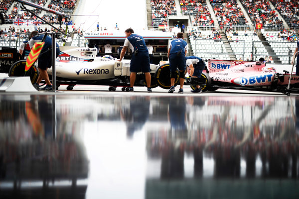Suzuka Circuit, Japan. Saturday 07 October 2017. Felipe Massa, Williams FW40 Mercedes, and Sergio Perez, Force India VJM10 Mercedes, return to the pits. World Copyright: Glenn Dunbar/LAT Images  ref: Digital Image _X4I5963