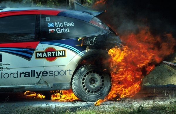 Colin McRae (GBR) had to evacuate his Ford Focus RS WRC after a loose hydraulic line caught fire at the end of stage 20.FIA World Rally Championship, Rd9, Neste Rally Finland, Finland. 8-11 August 2002.BEST IMAGE