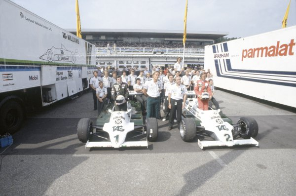1981 German Grand Prix.Hockenheim, Germany. 31 July-2 August 1981.Alan Jones and Carlos Reutemann (both Williams FW07C-Ford Cosworth). Group photograph including TAG owner Mansour Ojjeh and team principals Frank Williams and Patrick Head. Portrait.World Copyright: LAT PhotographicRef: 35mm transparency 81GER07