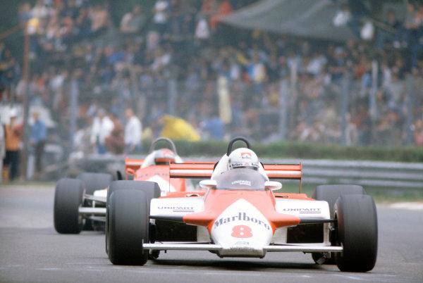 Monza, Italy. 11-13 September 1981.  Andrea de Cesaris (McLaren MP4/1-Ford Cosworth) 7th position, leads Mario Andretti (Alfa Romeo 179C).  Ref: 81ITA25. World Copyright: LAT Photographic