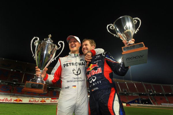 Rajamangala Stadium, Bangkok, Thailand 13th - 16th December 2012 Michael Schumacher and Sebastian Vettel with the R World Copyright: IMP (USAGE FREE FOR EDITORIAL PURPOSES ONLY)